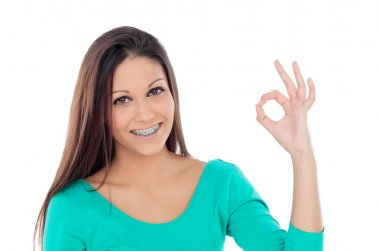 Smiling teenager girl with brackets saying Ok