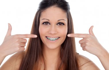 Attractive young woman pointing her brackets