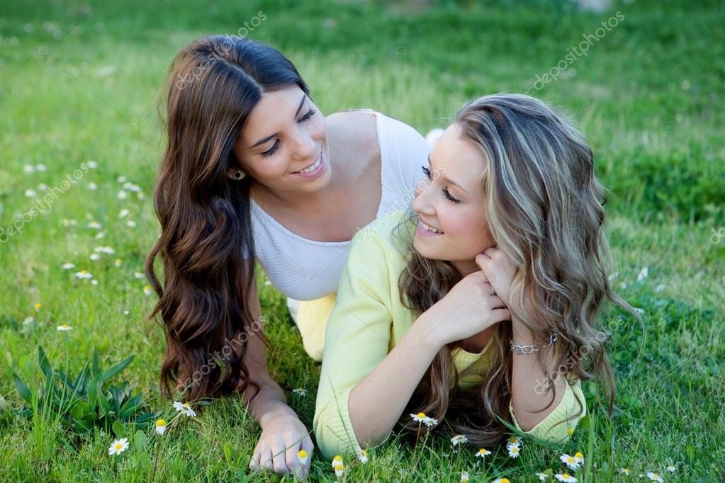 Two girls lying in grass and flowers