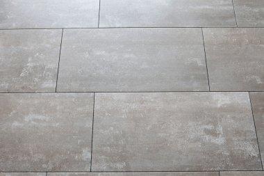Grey floors with large tile horizontally