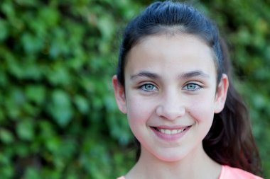 Happy preteen girl with blue eyes smiling