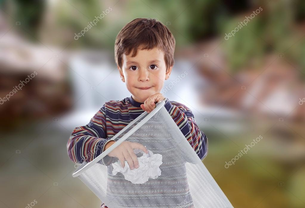 Little kid throwing a paper in the bin.