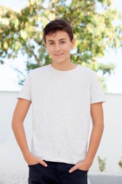 Teenage boy smiling outside