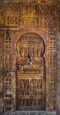 Ancient ornate wooden door
