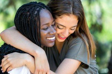embracing multiracial friends