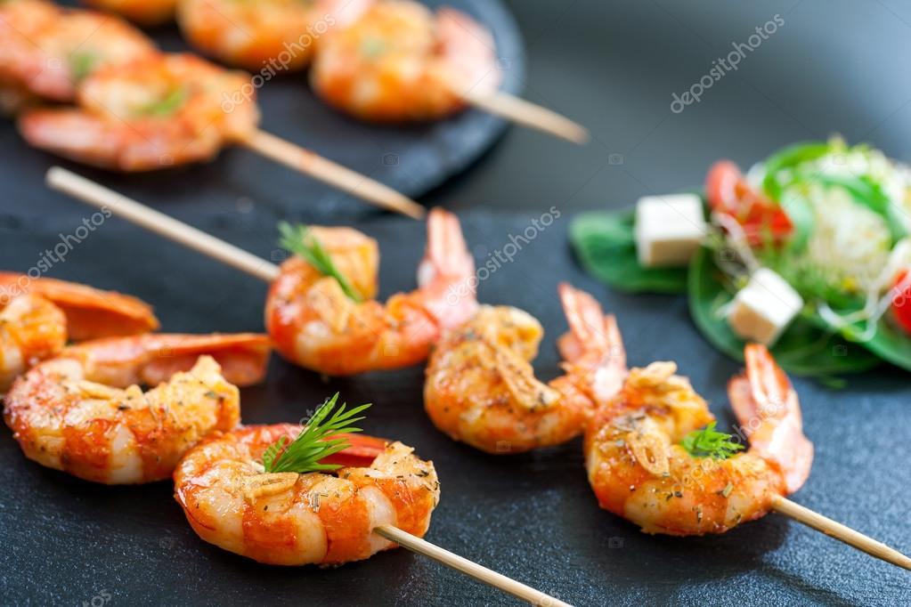 Catering shrimp brochettes.