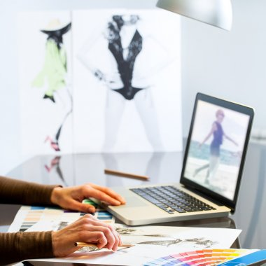 Fashion Designers hands creating design.