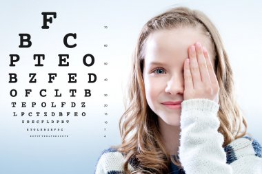 Close up portrait of Girl reviewing eye sight closing eye with hand.Test chart in background. stock vector