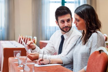 Business couple reviewing work