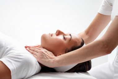 Close up of woman having osteopathic neck massage. Therapists hands doing manipulative treatment on neck stock vector