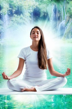 Attractive young woman meditating