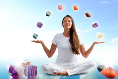 woman doing yoga with precious gemstones