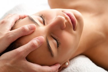 woman having curative facial massage