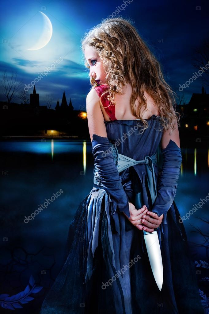 Girl standing with big knife