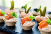 Pastry tartlets with smoked salmon filling.