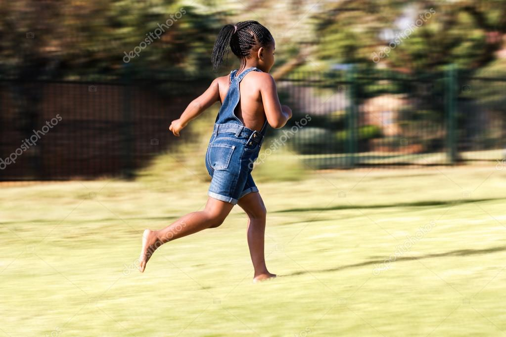 Rear view of african kid running