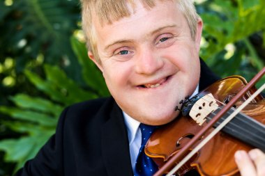 Handicapped violinist outdoors.