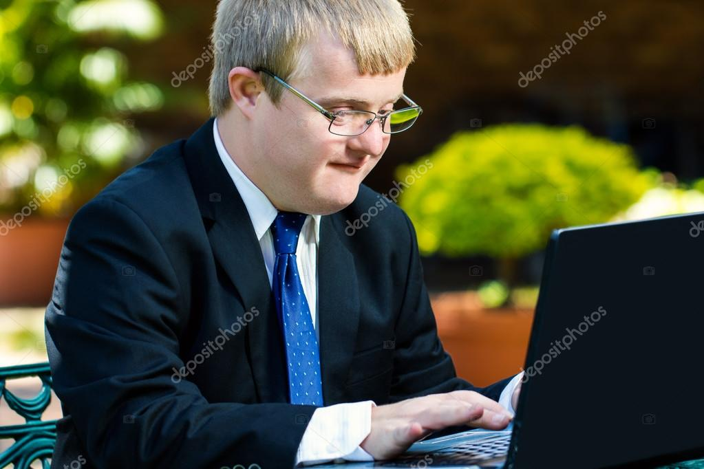 handicapped businessman working with laptop