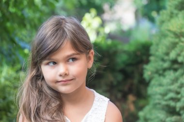 Attractive little girl with long hair