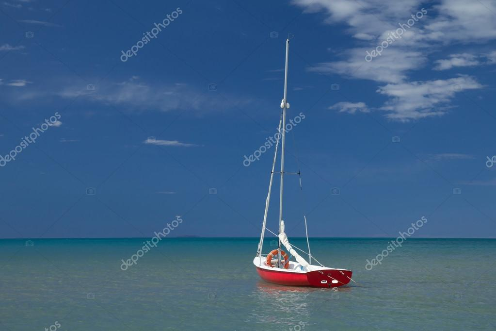 Alone red and white boat at the sea (Vertically)