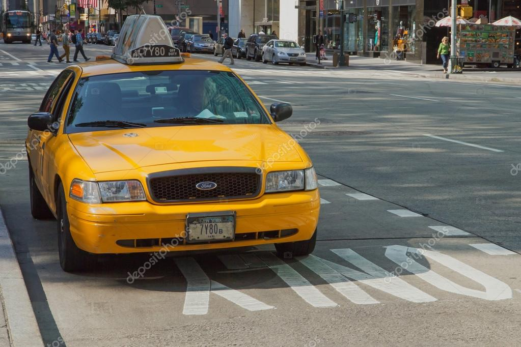 Taxi is standing at the curb – Stock Editorial Photo