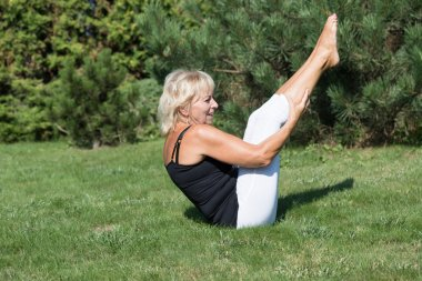 Senior woman is exercising  outdoors