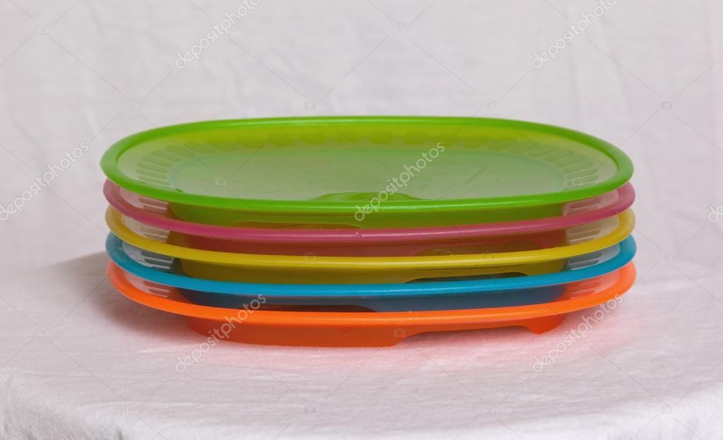Colorful plastic plates closeup isolated on white background u2014 Photo by michaklootwijk & Colorful plastic plates u2014 Stock Photo © michaklootwijk #100286548