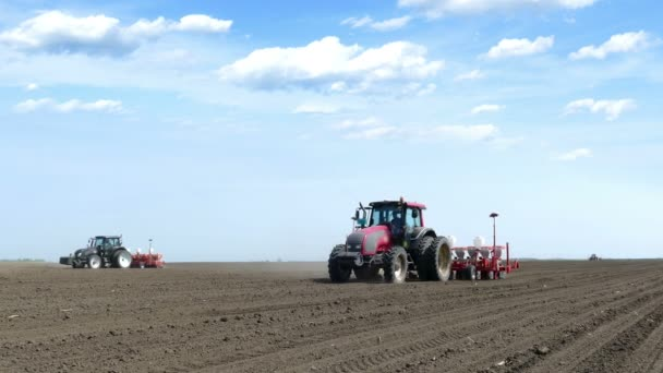 tractors and seeders sowing field