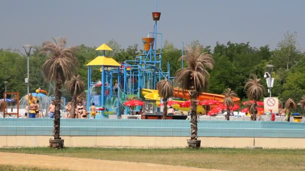 people relaxing in park with water rides