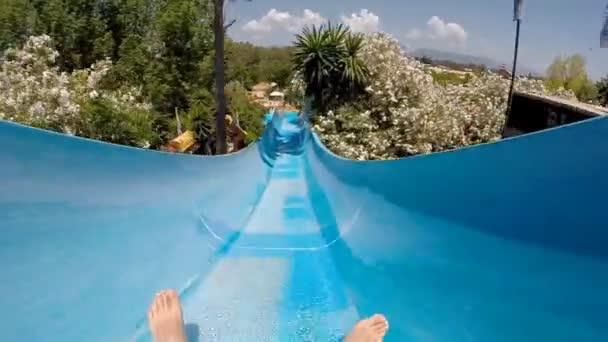 sliding down tube at aqua park