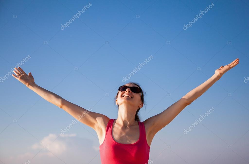 woman rejoices at summer vacation