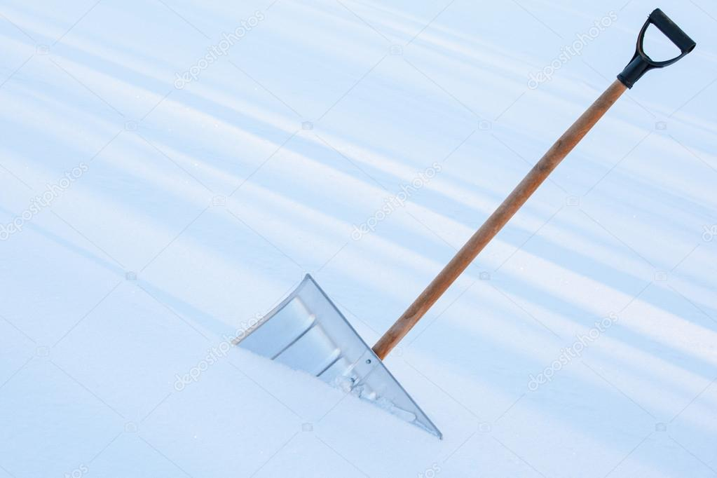 Snowshovel in the snowdrift - closeup