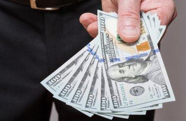 Businessman offering dollars