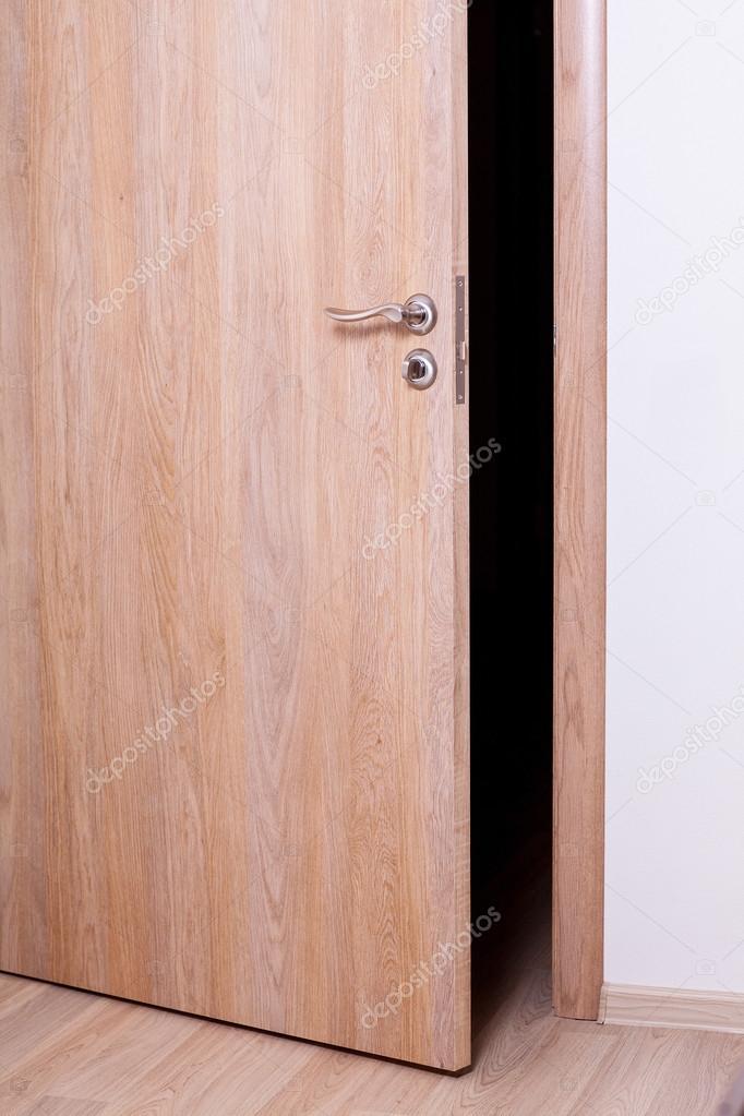 Close-up of room with wooden door ajar u2014 Photo by zestmarina & Room with door ajar u2014 Stock Photo © zestmarina #76131179