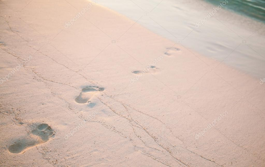 Fresh footsteps on the beach