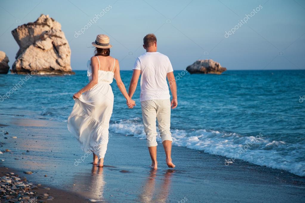 Couple walking along the seacoast