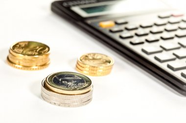 Euro coins and calculator