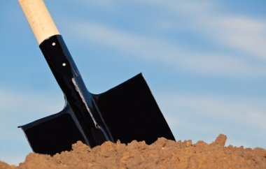 Shovel in the heap of ground