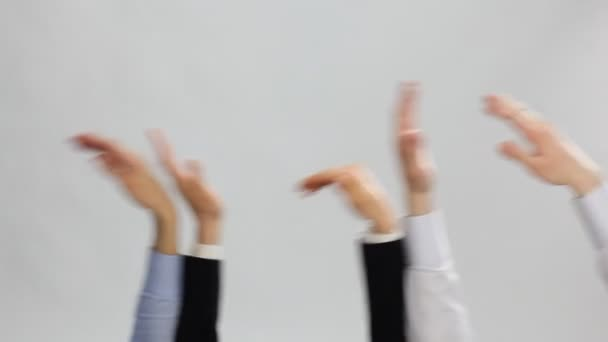 businessmen holding hands up and waving