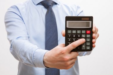 Businessman holding  calculator and counting