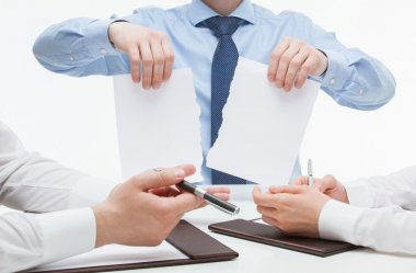 Business people cruelly tearing documents