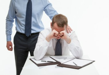 Businessman supporting his collegue in difficult situation