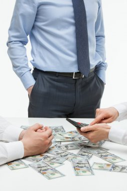 Business people counting money