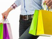 Fényképek boldog lány gazdaság bevásárló táskák