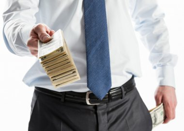 Businessman offering money