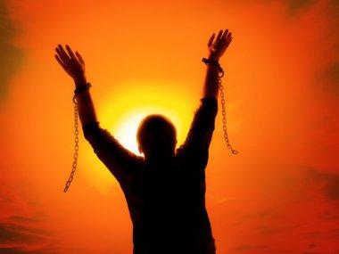 Man with chains broken apart