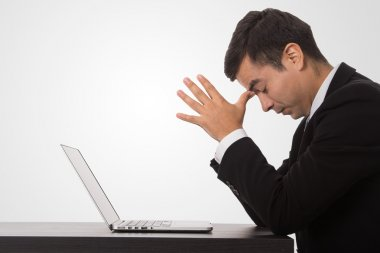 Overwhelmed stress businessman overload feeling on the computer laptop