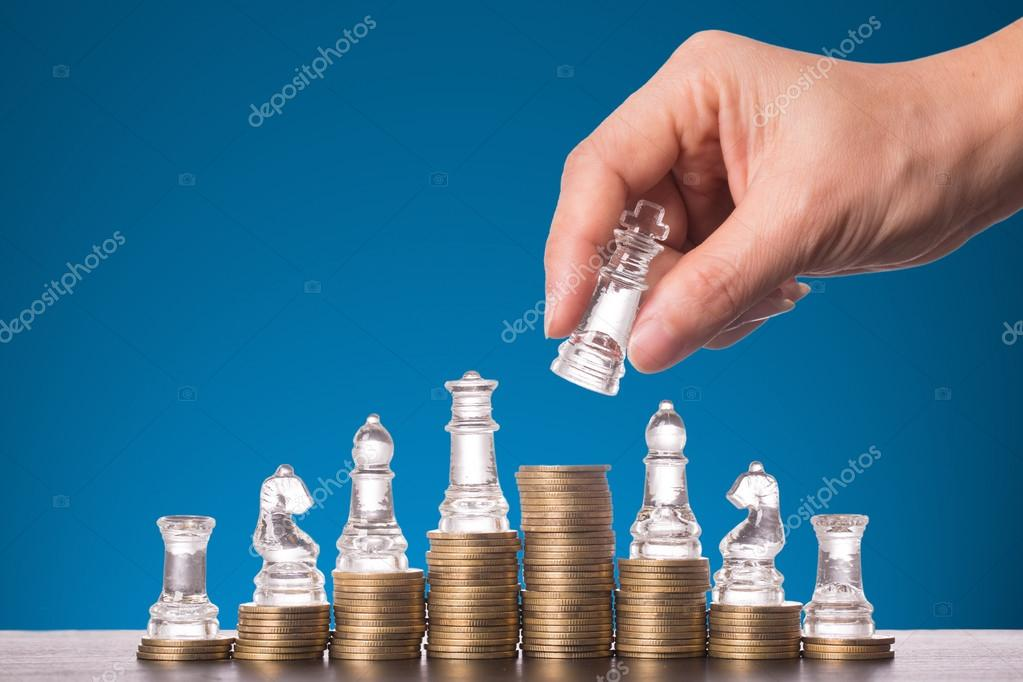 Business competition with chess game and coin concept
