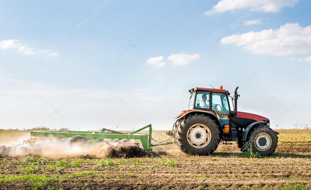 Tractor preparing land