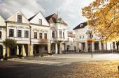Fotografie Historical town square early morning in sunshine (Zilina, Slovakia)